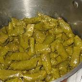 Dolmathakia: Stuffed grape leaves with beef, pork, and rice, ready to cook