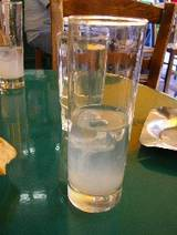 A simple glass of ouzo at an ouzeria in Greece.
