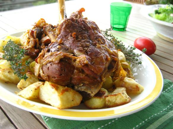 Pot roasted leg of lamb with garlic and cheese