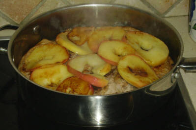 Add the apple rings to the browned pork chops.
