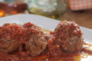 Stuffed Veal Cooked in Aromatic Tomato Sauce